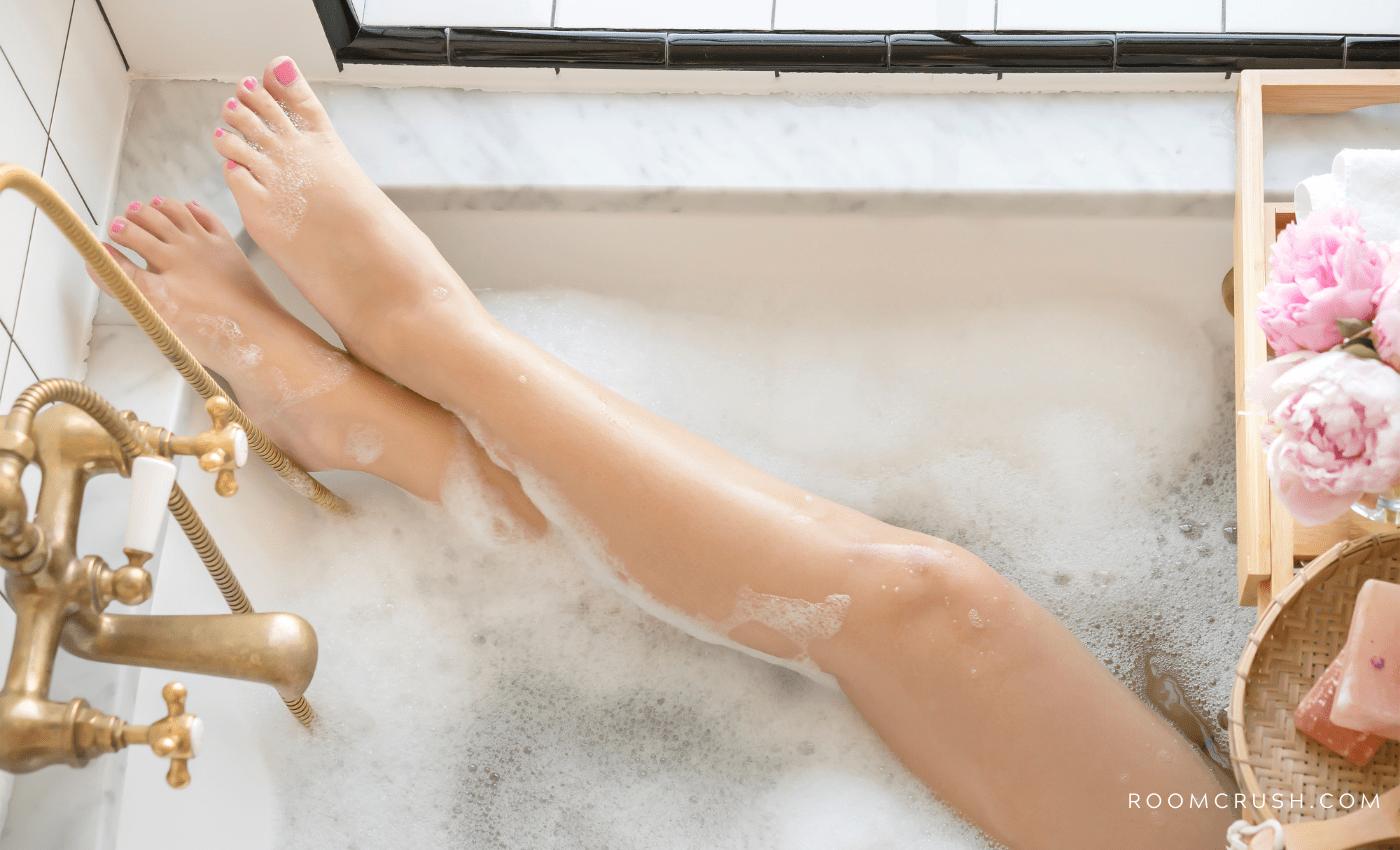 Tiny Bathroom Makeover Ideas - Stylish woman enjoying her small bathroom renovation idea